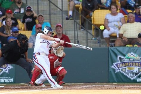 USSSA Pride outfielder Megan Wiggins (25) hits a homer out to right field to start the Pride's at bat