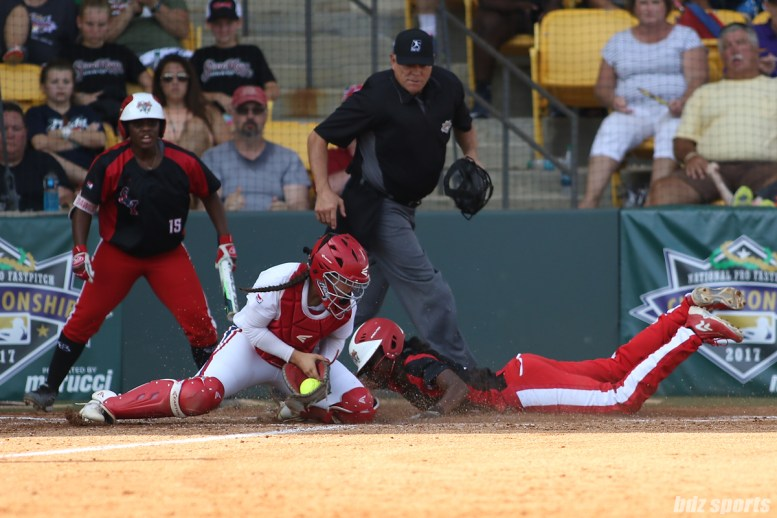 Scrap Yard Dawgs Kayla Winkfield (9) slides and beats the tag at home to score for the Dawgs