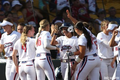 USSSA Pride Sierra Romero (32) is high fived by teammates after scoring in the 3rd inning