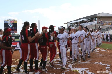 The USSSA Pride and Scrap Yard Dawgs shake hands after the Dawgs defeat the Pride 5 - 2 to with the 2017 NPF Cowles Cup
