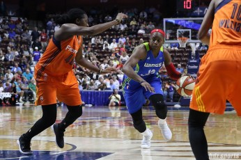 Dallas Wings forward Karima Christmas-Kelly (13) drives to the basket
