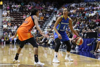 Dallas Wings guard Skylar Diggins-Smith (4) controls the ball for the Wings