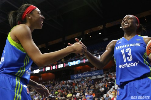 Dallas Wings guard Aerial Powers (23) and forward Karima Christmas-Kelly (13) high five after a play