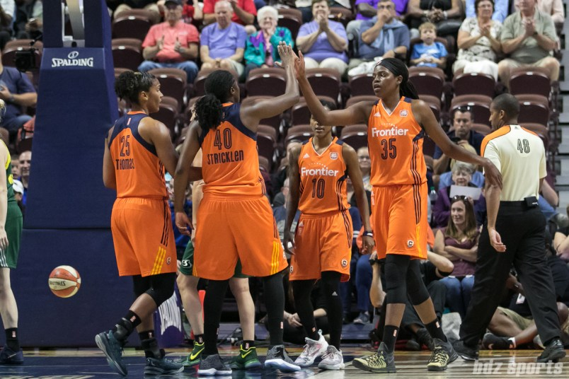 Connecticut Sun center Jonquel Jones (35) high fives teammate Shekinna Stricklen (40) after drawing a foul.