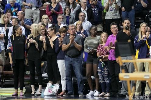 UCONN women's basketball head coach Geno Auriemma applauds as UCONN women's basketball assistant coach Chris Dailey is awarded the Margo Dydek Award.