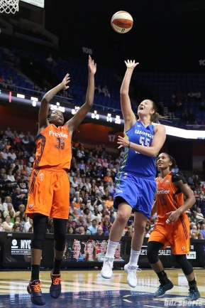 Dallas Wings forward Theresa Plaisance (55) looks to float in a basket