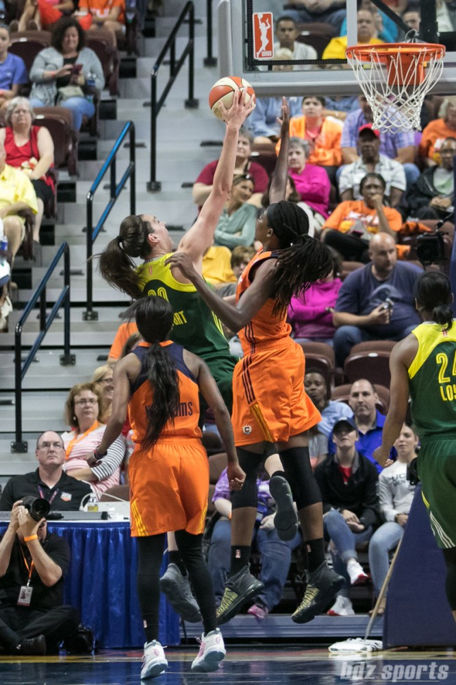 Seattle Storm forward Breanna Stewart (30) drives to the basket against Connecticut Sun center Jonquel Jones (35).