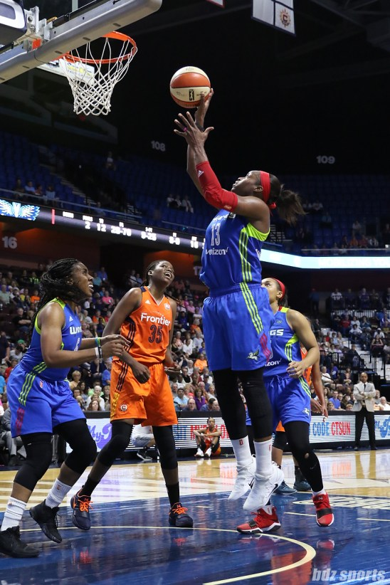 Dallas Wings forward Karima Christmas-Kelly (13) jumps to lay in the basket