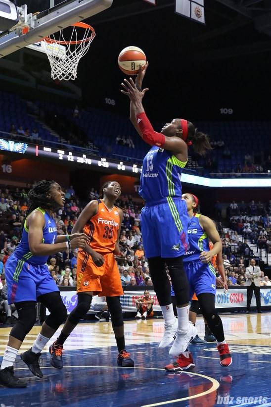 Dallas Wings forward Karima Christmas-Kelly (13) jumps to lay in the basket