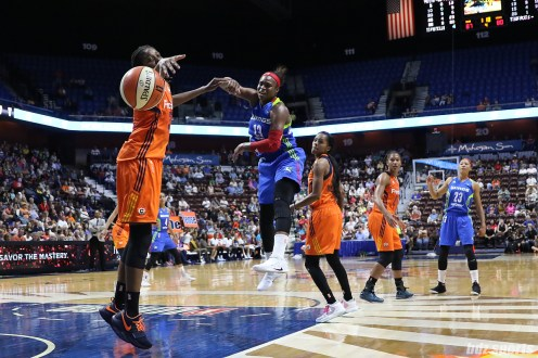 Connecticut Sun center Jonquel Jones (35) and Dallas Wings forward Karima Christmas-Kelly (13) look on as the ball heads out of bounds