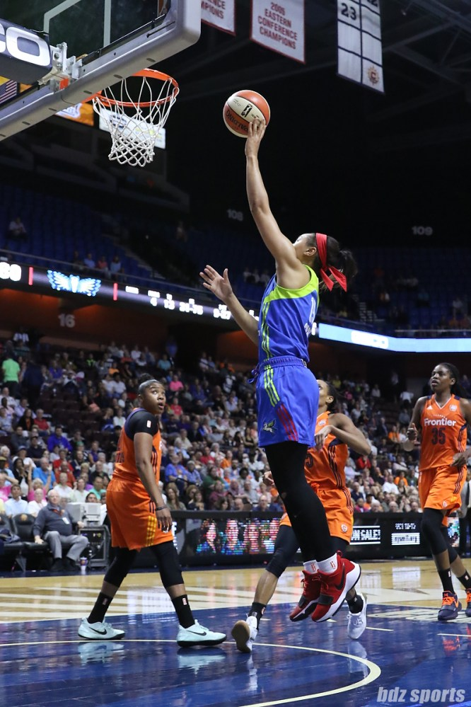 Dallas Wings guard Allisha Gray (15) lays in a basket