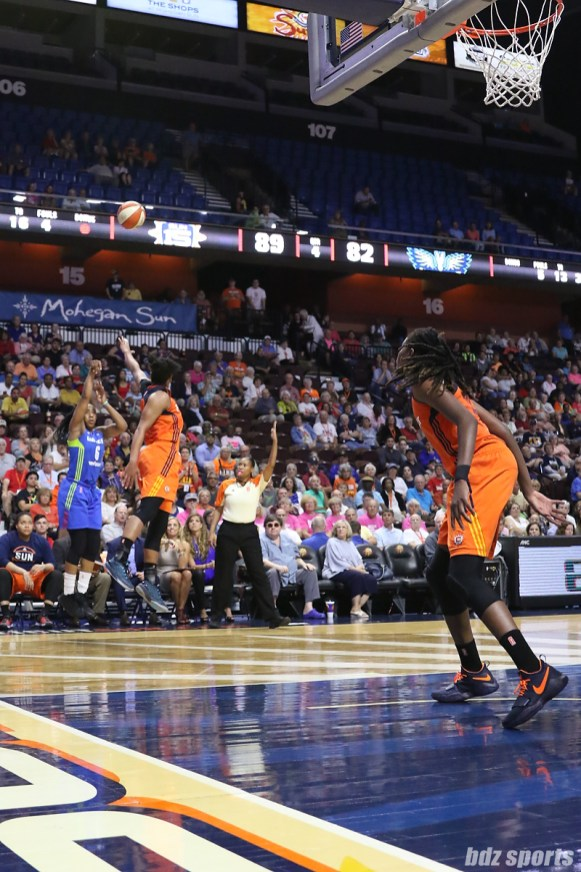 Dallas Wings forward Kayla Thornton (6) takes a 3-point shot from the corner
