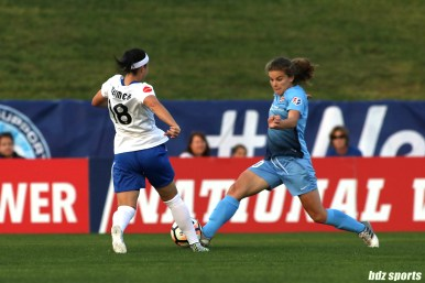 Boston Breakers forward Tiffany Weimer (18) challenges Sky Blue FC midfielder Daphne Corboz (10) for the ball