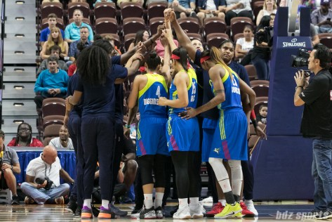 The Dallas Wings huddle before the start of the game.
