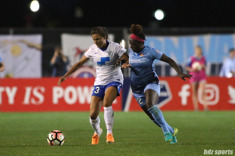 Boston Breakers forward Katie Stengel (23) shields the ball from Sky Blue FC defender Mandy Freeman (22)