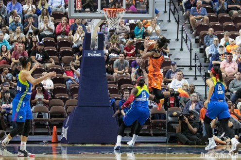 Connecticut Sun forward Alyssa Thomas (25) goes airborne to lay in a basket.