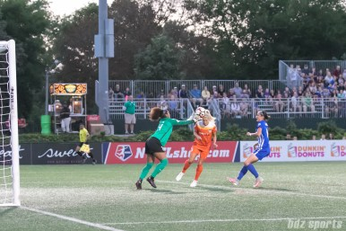 Boston Breakers goalkeeper Abby Smith (14) looks to punch away the ball as Houston Dash forward Rachel Daly (3) tries to head the ball on
