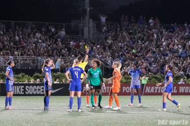 Boston Breakers goalkeeper Abby Smith (14) is shown the yellow card