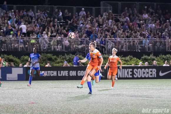 Houston Dash midfielder Amber Brooks (12) heads the ball back to her goalkeeper