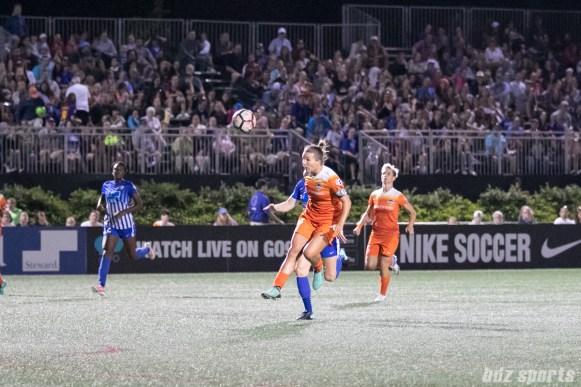 Houston Dash midfielder Amber Brooks (12) heads the ball back to her goalkeeper