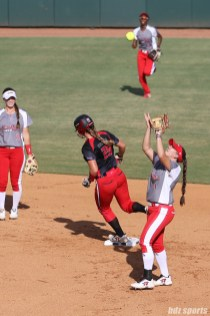 Scrap Yard Dawgs infielder Hannah Flippen (1) makes the catch for the last out of the inning