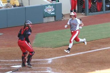 Scrap Yard Dawgs infielder Hannah Flippen (1) scores for the Dawgs