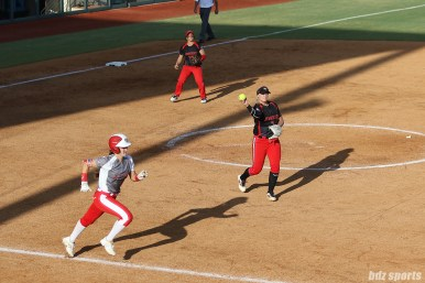 Akron Racers pitcher Megan Betsa (7) makes the throw to first base