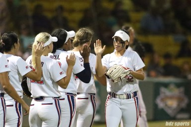 USSSA Pride second baseman Sierra Romero (32) high fives her teammates before the start of the game