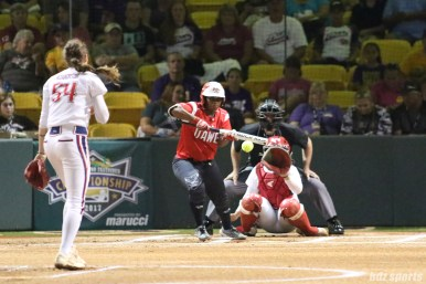 Scrap Yard Dawgs second baseman Nerissa Myers (15) lays down a bunt