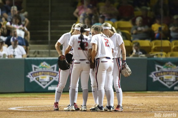 The USSSA Pride infield huddles before the start of the inning