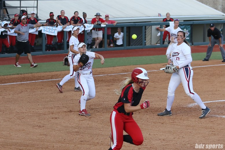 USSSA Pride first baseman Hallie Wilson (22) makes a throw to first base