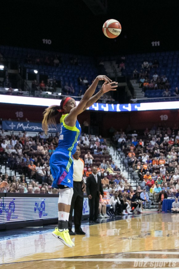 Dallas Wings forward Glory Johnson (25) releases a shot near the arc.
