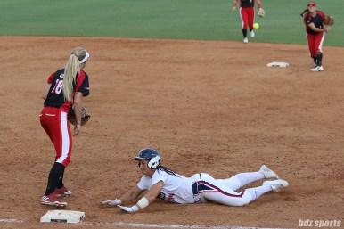 USSSA Pride designated hitter Lauren Chamberlain (44) slides to get back to first base