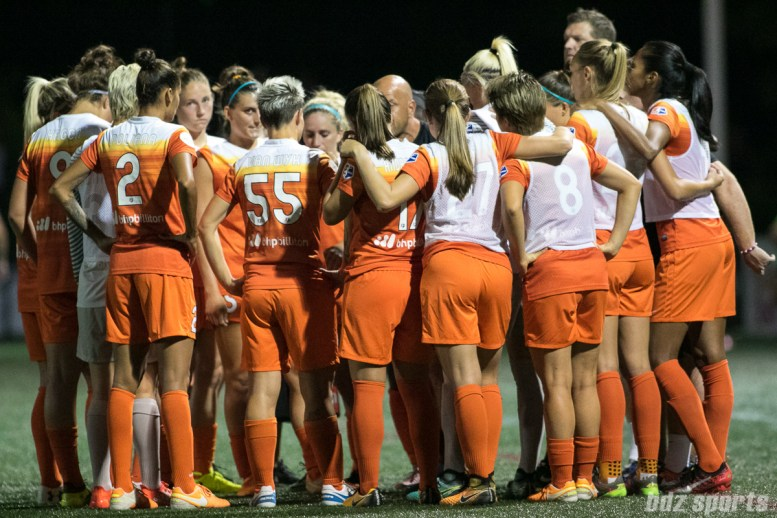 The Houston Dash huddle prior to the start of the second half.