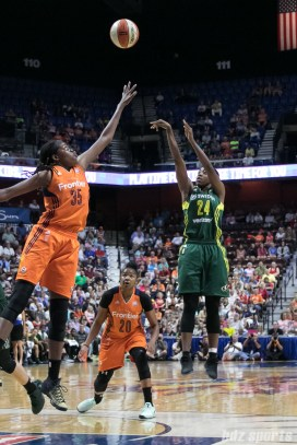 Seattle Storm guard Jewell Loyd (24) releases a shot over the hand of Connecticut Sun center Jonquel Jones (35).
