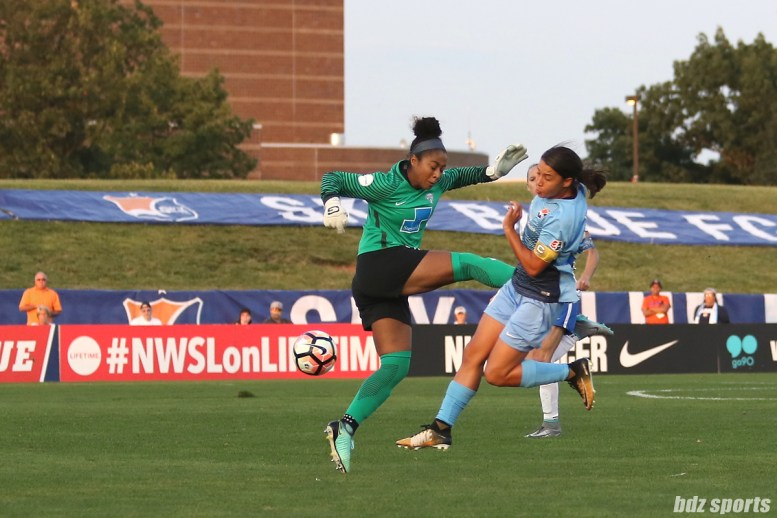 Boston Breakers goalkeeper Abby Smith (14) challenges Sky Blue FC forward Sam Kerr (20) for a loose ball