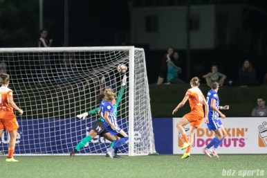 Houston Dash midfielder Amber Brooks (12) finds the back of the net for the Dash's second goal of the game.