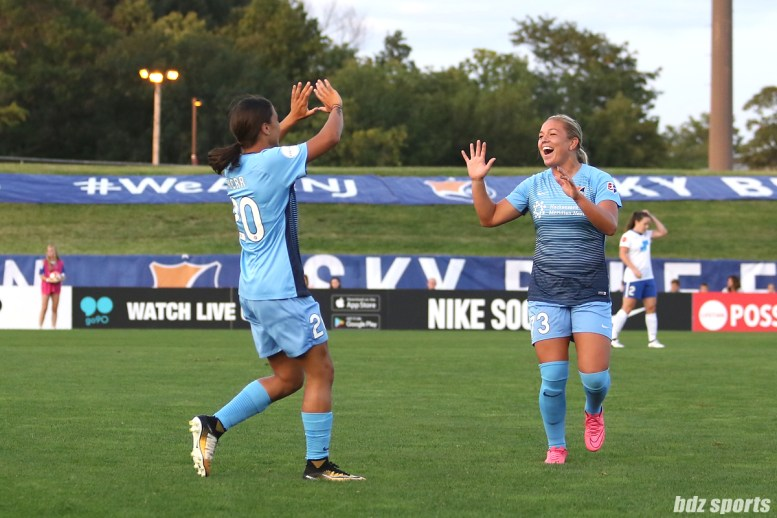 Sky Blue FC forward Sam Kerr (20) celebrates her goal with teammate Madison Tiernan (73)