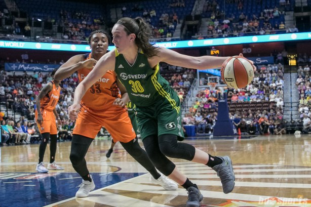 Seattle Storm forward Breanna Stewart (30) drives to the basket against former UCONN teammate Connecticut Sun forward Morgan Tuck (33).