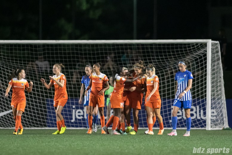 The Houston Dash celebrate teammate Sarah Hagen (9) second goal of the game