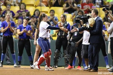 USSSA Pride catcher Chelsea Goodacre (77) receives the Rawlings Golden Glove prior to the start of the game