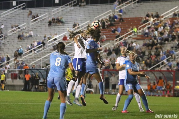 Boston Breakers defender Julie King (8) challenges Sky Blue FC defender Domi Richardson (17) for a ball in the air