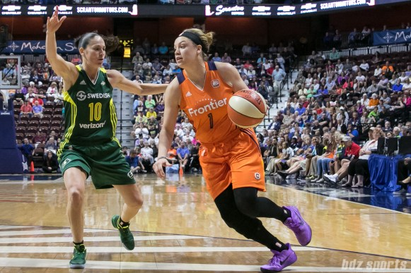 Connecticut Sun guard Rachel Banham (1) dribbles the ball while being defnded by Seattle Storm guard Sue Bird (10).