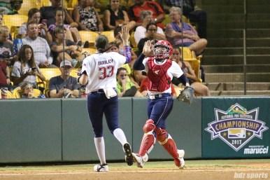 USSSA Pride pitcher Kelsey Nunley (33) high fives catcher Chelsea Goodacre (77)