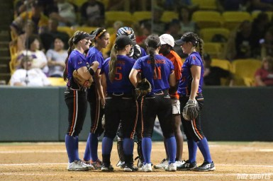 The Chicago Bandits infield huddles together