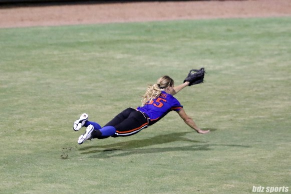 Chicago Bandits outfielder Brenna Moss (55) extends fully to make the diving catch
