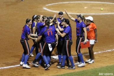 The Chicago Bandits high five at the end of the inning