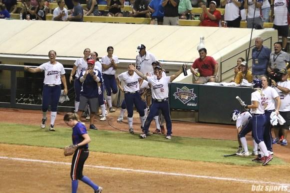 The USSSA Pride celebrates teammate Lauren Chamberlain's triple