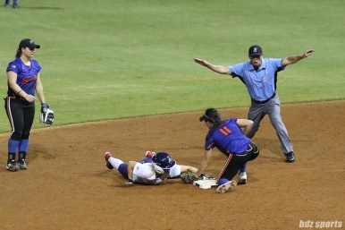 The umpire rules USSSA Pride player Hallie Wilson (22) safe at second base