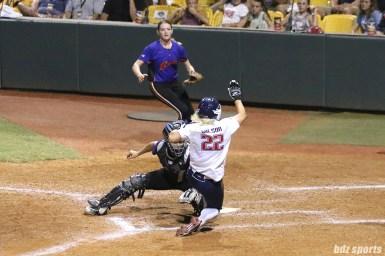 USSSA Pride first baseman Hallie Wilson (22) slides into home plate